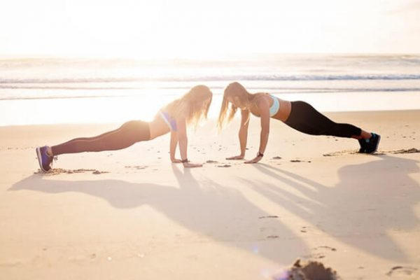 two-women-planking-at-the-seashore-1199607 (1)